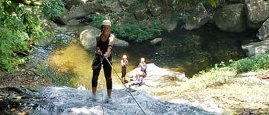 woman waterfall rappelling belize