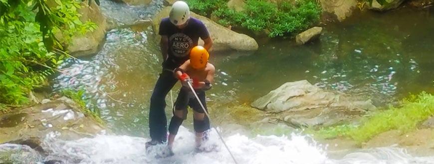 little boy waterfall rappelling in belize